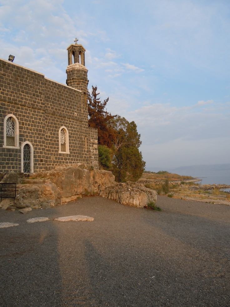 The Church of the Primacy of St. Peter is a Franciscan church located in Tabgha, Israel, on the northwest shore of the Sea of Galilee. It marks the site where, according to Christian tradition, Jesus appeared to his disciples for the third time and confirmed the spiritual primacy of the Apostle Peter [Jesus' reinstatement of Peter as chief among the Apostles.] - Photo: Bruce Bryant