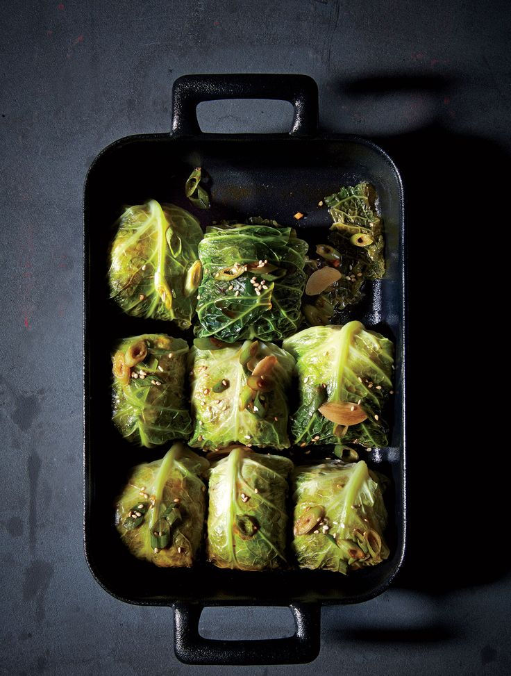 Pork and Broken Rice Cabbage Rolls - The cabbage rolls you're likely most familiar with are a relic of Eastern European cuisine: filled with ground beef and rice and simmered for hours in tomato sauce. These cabbage rolls across several cuisines, however, and adopts a Far East approach here. Savoy cabbage leaves have distinct curly edges and a bumpy, web-like texture that make them perfect for stretching over the pork filling. www.cookinglight.com/recipes/pork-broken-rice-cabbage-rolls