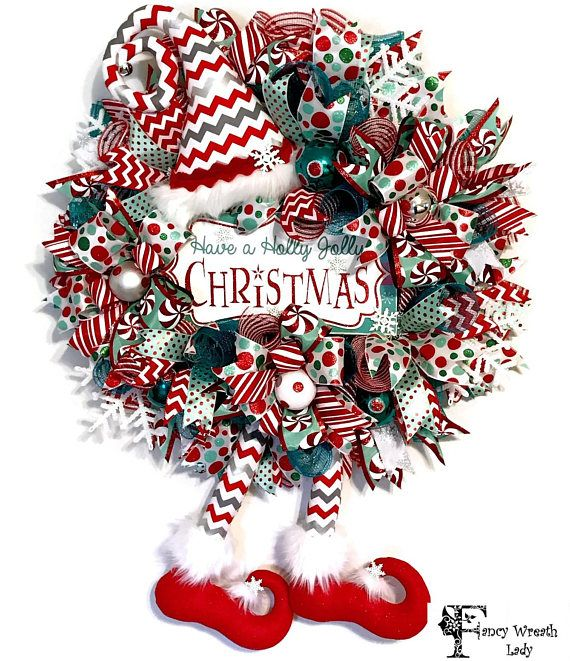 ELF WREATH, Turquoise and Red Christmas Elf Wreath, Christmas Wreath, Elf Holiday Wreath, Holiday Wreath, Winter Wreath, Ready to Ship Welcome your Guests with this adorable turquoise and red elf wreath. This wreath is made with yards and yards of deco mesh, large multi-ribbon bows,