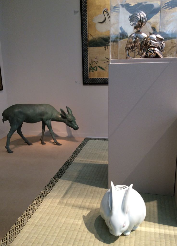 All nice things from Japan gather together at Gregg Baker Asian Art stand D34 at Art Antiques London 2014. A silver Pekingese dog playing with a cloisonné ball, a bronze doe and a porcelain rabbit incense burner by Makuzu Kozan