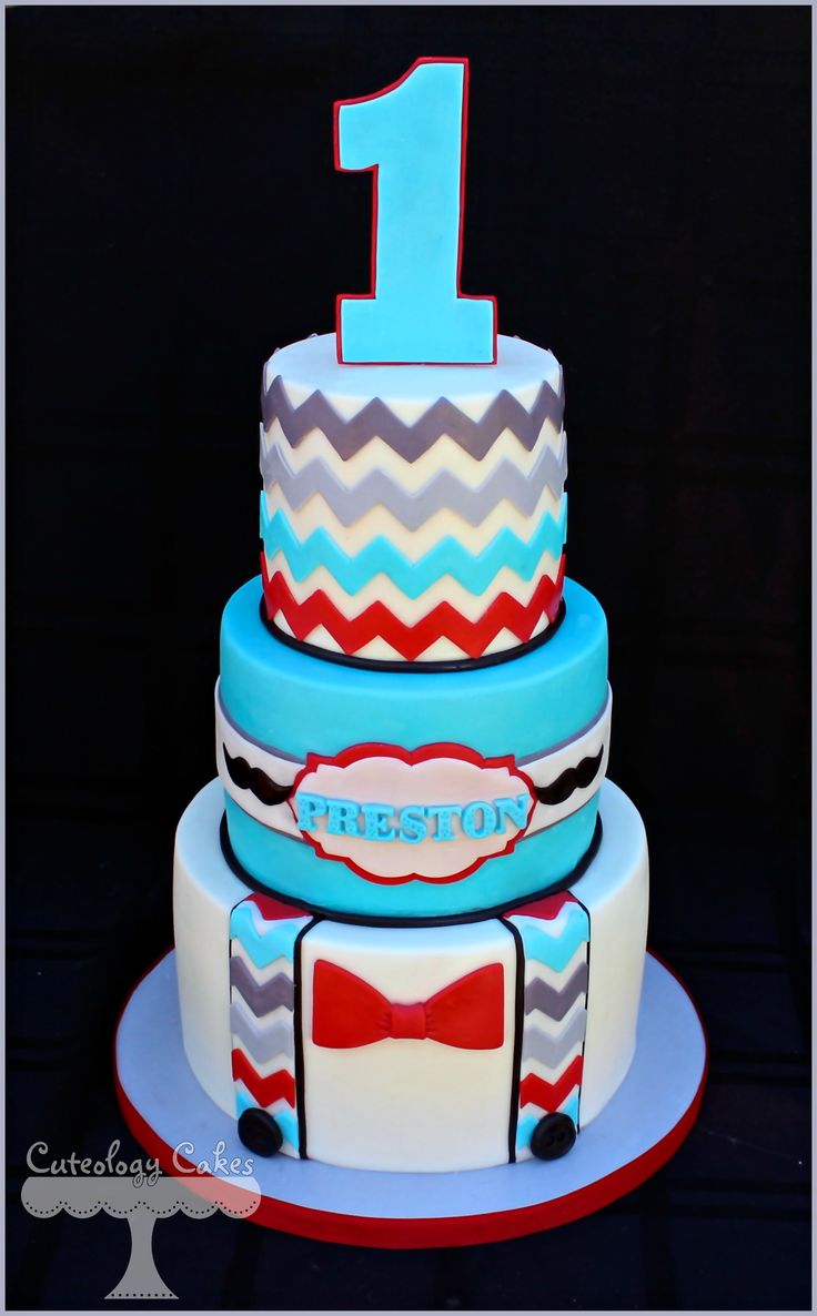 Little Man themed Cake with suspenders, chevron and mustaches.  www.facebook.com/i.love.cuteologycakes