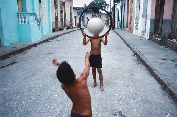 """Alex Webb- I chose this photograph because of the """"decisive moment"""" Webb caught during this playful shot."""