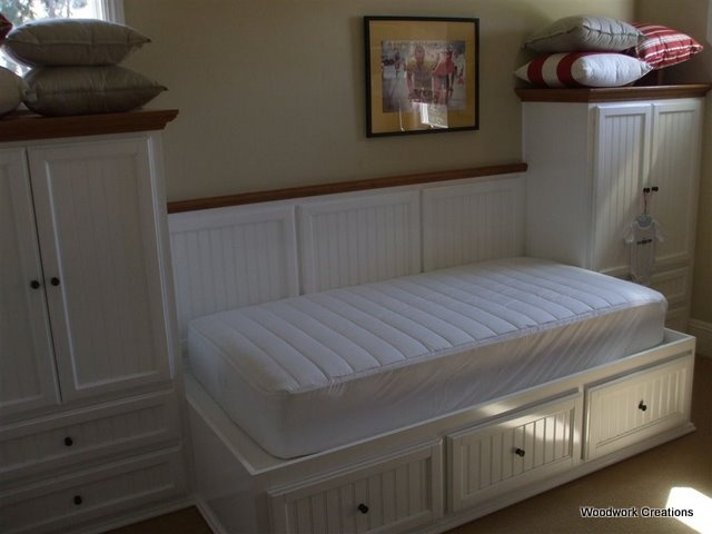 built in bed I want to put floor to ceiling shelves and