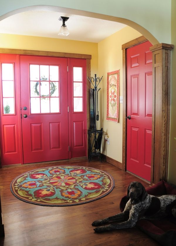 I like that the inside doors are brightly painted. What a great way to add color! Love the circular rug in the entry!