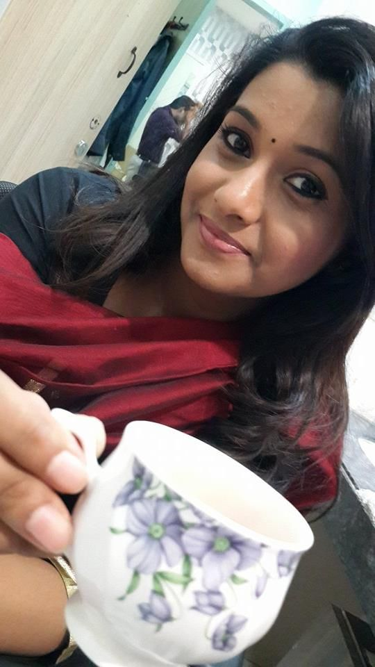 Priya Bhavani Shankar Drinking Coffee