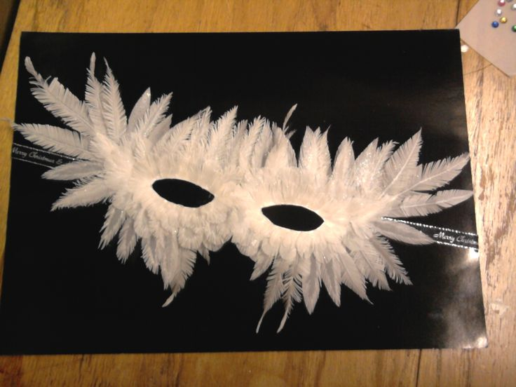 My own design Xmas party was wigs or masks the mask is made if parchment feathers about 50 all cut by hand
