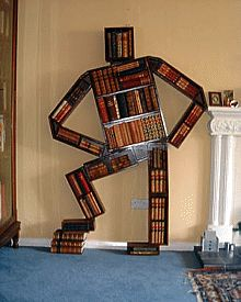 The Bookman is a stained pine bookshelf in the shape of a man and is a  highly decorative piece of furniture as well as a sculpture. He's awesome.