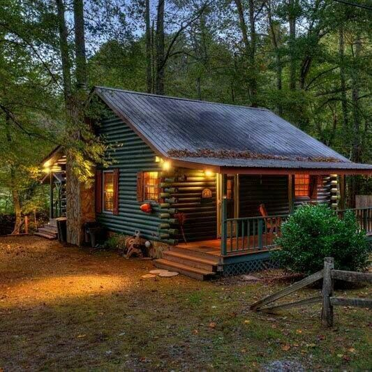 Mountain Vagabond.... Big fan of the large porches on this cabin! Tin roof fan as well.