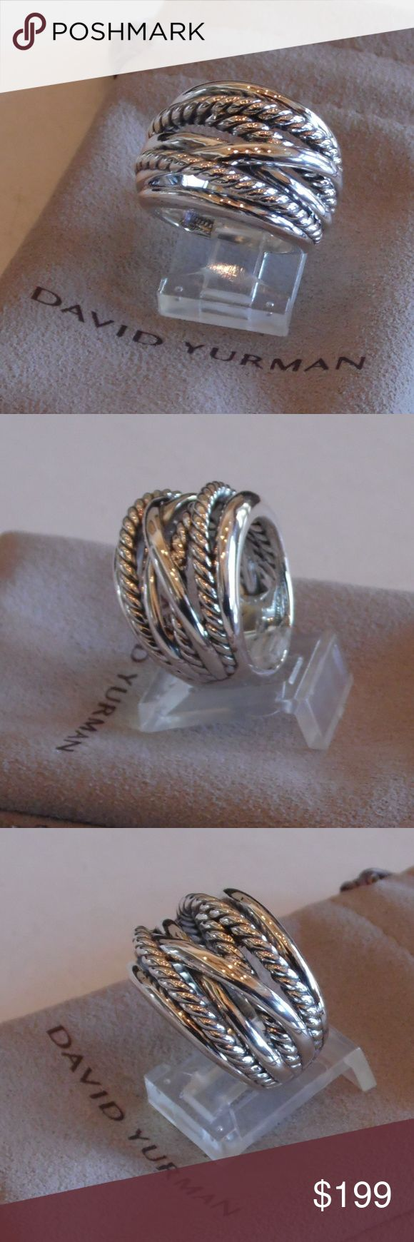 David Yurman New Wide Crossover Silver Ring 6 New without tags David Yurman New Wide Crossover Sterling Silver Ring Size 6. No signs of wear. Comes with a David Yurman white or brown pouch in excellent condition. Hallmarked copyright symbol D.Y. 925.  Face measures 18mm wide and 8mm wide on the underside of the band (approximate).  The hallmark is small and hard to see especially if held up to the light because is it so shiny. Recommend using a magnifying glass if you can't see it.  Picture…
