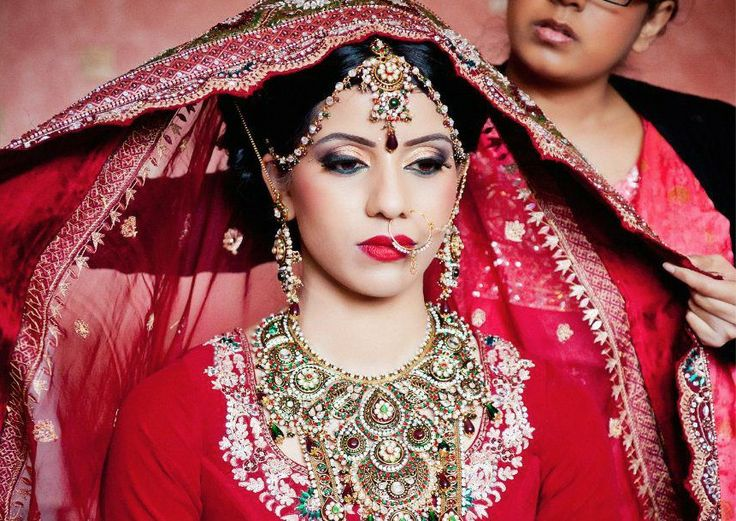 Photo via Deena MUA indian bride, red lipstick, heavy statement necklace, nath (nose ring),