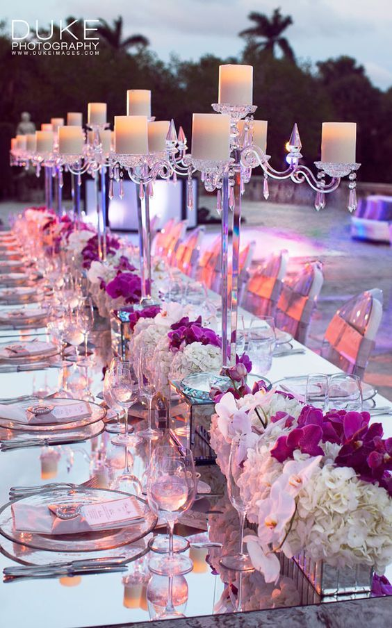 Mirrored dcor and candelabra centerpieces add a