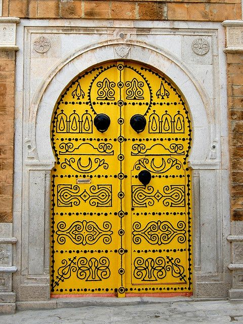 yellow door with black scrollwork