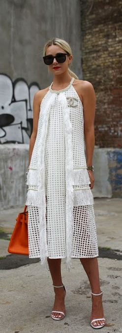 Blair Eadie is wearing a white mesh dress from Self Portrait, shoes from Stuart Weitzman and a bag from Hermes