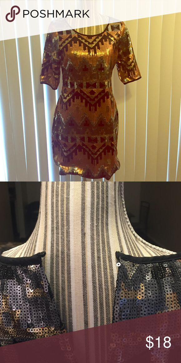 Sequin Party Dress Very sparkly Aztec design dress. Good condition but is missing a button on the back. Only worn a couple of hours because it was too small and that's why the button is missing. Great for a New Years party! 🎉 Dresses Mini