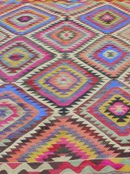 This kilim rug with traditional Barak nomads pattern has stunning colors such as blue, pink, purple and brown.