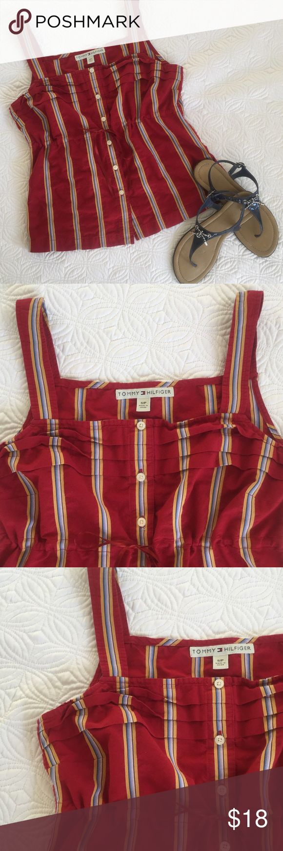 """Tommy Hilfiger striped top This cute top from Tommy Hilfiger looks great with shorts, capris and jeans. Size S. Made from 100% cotton. Length in front is 16"""" from the neck to the hem. Length from the back of the neck to the hem is 17"""". Tommy Hilfiger Tops Blouses"""