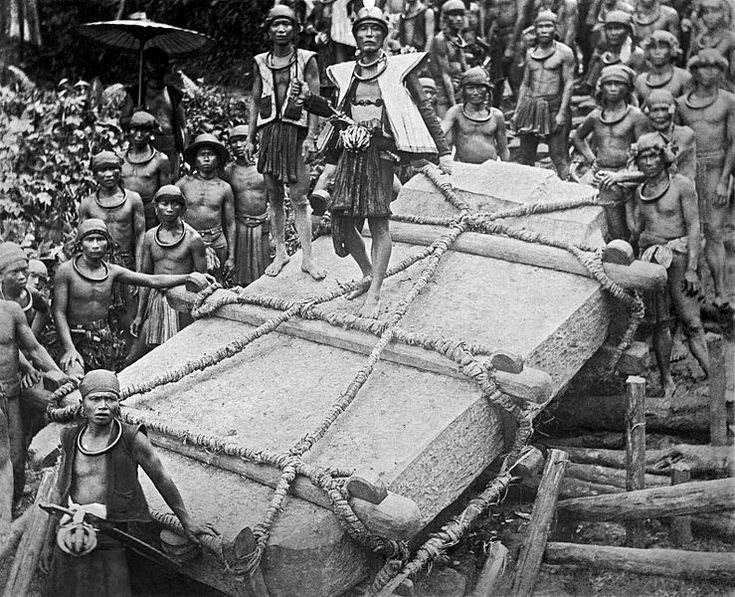 People on Nias Island in Indonesia move monoliths to a construction site, circa 1915.