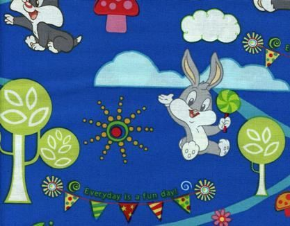 """This pattern includes a display of Loony Tunes over a royal blue background and is splendid print to use for children's items,shirts,skirts and other garments are other possible uses.  * Cotton 100% * Width 45 inches * Primary color is Royal Blue """"If you buy more than one item it will be sent in one uncut continuous piece unless otherwise specified.  Measures 18 x 45 inches Price by HALF YARD"""