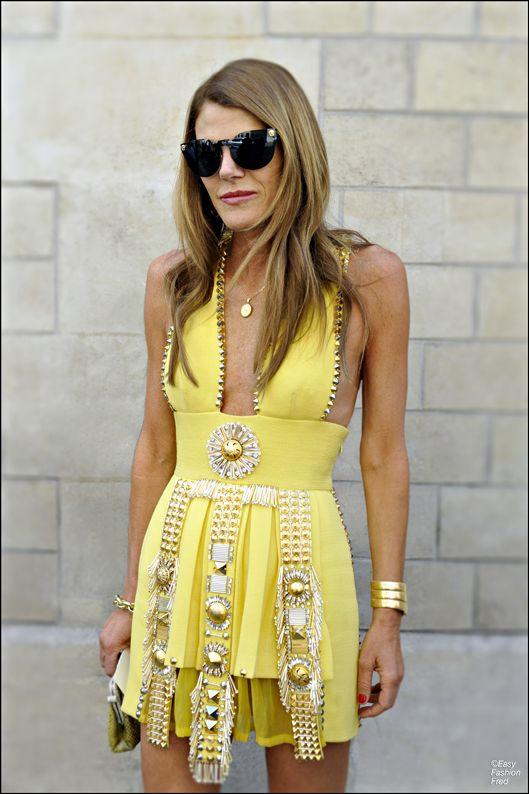 Anna Dello Russo in Fausto Puglisi dress, Versace sunglasses, & Bulgari watch
