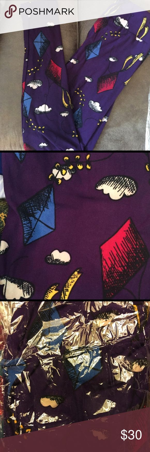 Lularoe OS kite leggings NWT Purple background with kites. Size OS (fits 2-12) NWT. LuLaRoe Pants Leggings