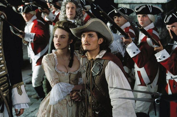 Orlando Bloom and Keira Knightley ~ As Elizabeth Swann and Will Turner in Pirates of the Caribbean: The Curse of the Black Pearl (2003) ~ The Greatest Movie Couples Ever