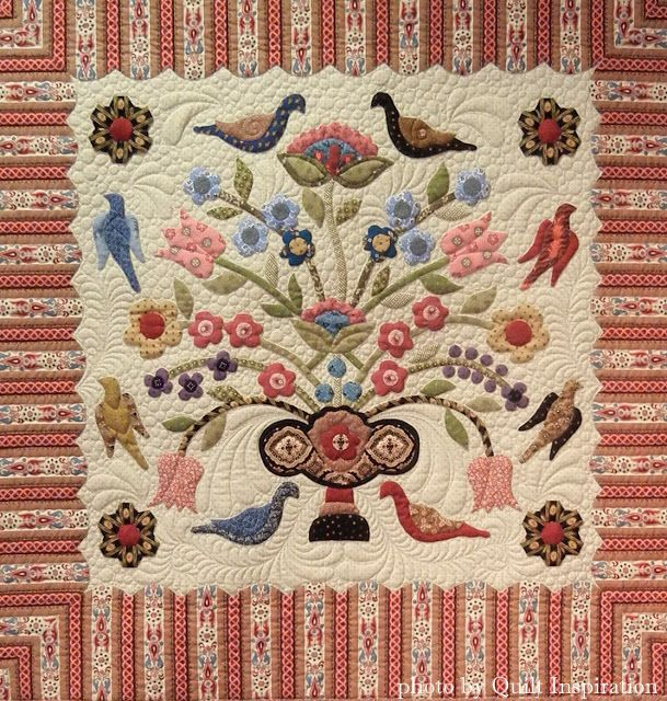 Ann's Legacy by Sue Maitre, quilted by Linda Hrcka, pattern by Di Ford. First Prize - Applique Large, along with the Larene Sinema Founder's Award for Exemplary Workmanship, at the 2015 Arizona Quilters' Guild Show. Photo by Quilt Inspiration.
