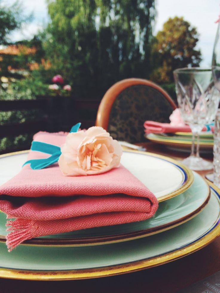 Pink napkins, vintage cutlery. Romantic tabletop. Vintage, Bavaria porcelain plates and cristal glasses. Outdoor dinner.