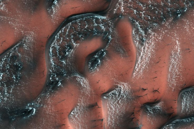 It was spring in the Northern hemisphere when this image was taken on May 21, 2017, by the HiRISE camera on NASA's Mars Reconnaissance Orbiter. Over the winter, snow and ice have inexorably covered the dunes. Unlike on Earth, this snow and ice is carbon dioxide, better known to us as dry ice.