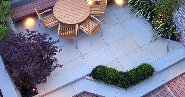 green ideas for rooftop patio with round wooden table and chairs plus large tiles flooring surrounded with border side garden
