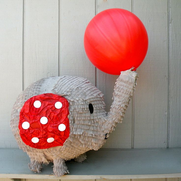 This sweet elephant piñata would make a great centerpiece at your next circus or carnival party!16 inches*Balloon is a photo propAll pieces are handcrafted in southern California upon order and take between 2-3 weeks to process. Rush orders may be available if our schedule permits so feel free to contact us if youre interested.Well add up to 20 pull ribbons at no extra charge upon request. A 5 dollar fee will apply if you require more than 20 ribbons.Piñatas co...