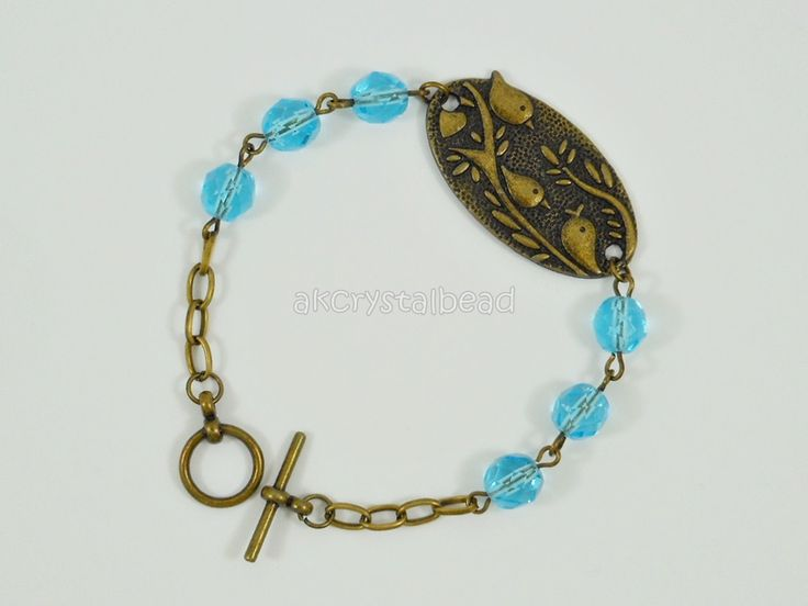 Bronze bird and blue aquamarine Czech fire polished bead bracelet. FSM0083