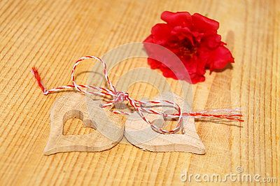 Wooden hearts and red flower
