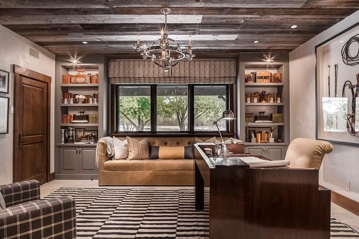 Charming Country Home Office Features An Armillary Sphere Chandelier Hung From A Rustic Plank Ceiling Over Stone Floor Tiles Covered In Black And