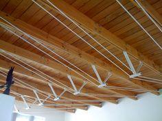 Armaduras híbridas. Tablones de madera con tensores de acero  Cubierta en Jurica Querétaro.  Arq. Arturo Ríos