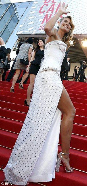 Heidi Klum in a gem studded gown at Nebraska premiere. That's a great leg!