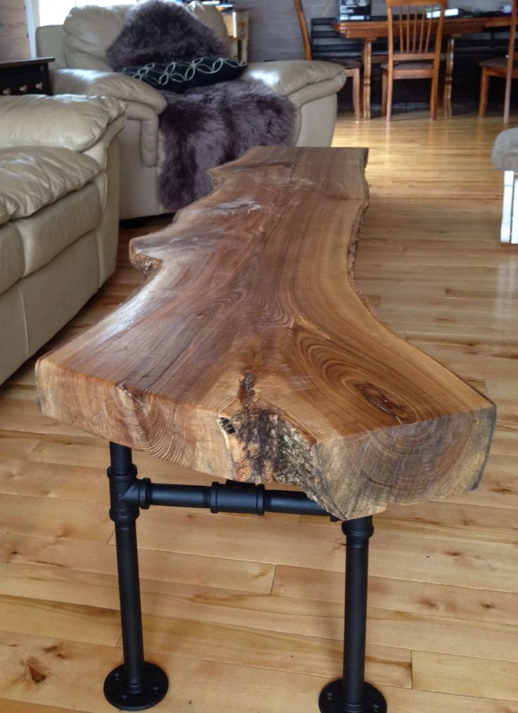 New coffee table we made from black ash and galvanized steal piping.