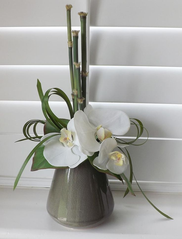 White Orchids and Bamboo in Grey Vase