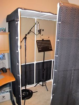 ATS Acoustic Panels backed by blankets and suspended from a PVC frame.