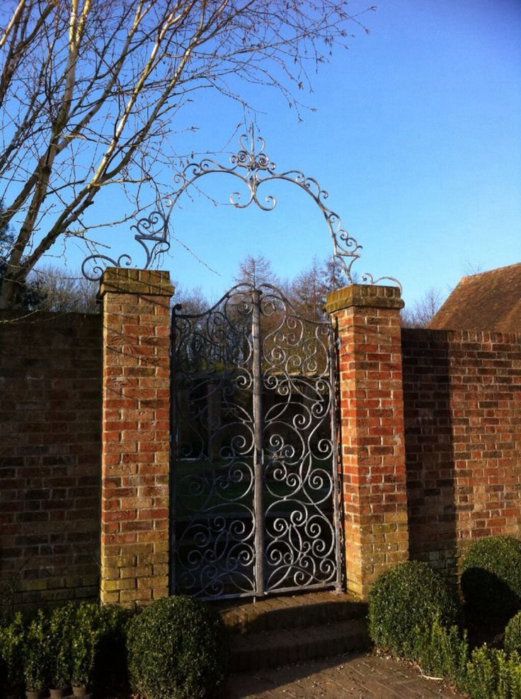 Custom forged court yard gate and arch.