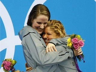 Missy Franklin (USA), gets a hug from Elizabeth Beisel (USA), after receiving their gold and bronze medals for the women's 200m backstroke. Missy set a new World Record with her Gold swim.