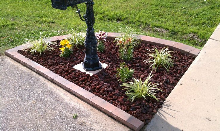 Mailbox Flowerbed: 18 Stone blocks, 21 Capstones, variegated lariope, Asiatic lilies (tiny series), and lava rocks.  The stone blocks and capstones were purchased from Lowes (Allen & Roth brand). The lily names are (l to r) tiny bee, tiny padhye, tiny sensation, and tiny spider.