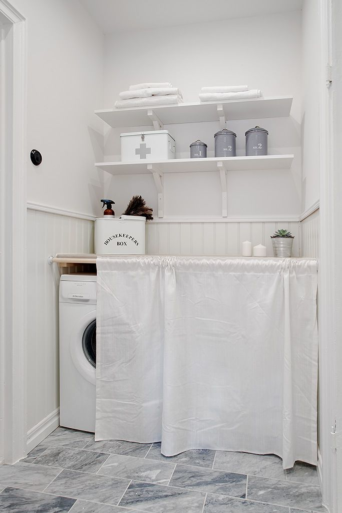 laundry room//clever way to hide what's behind..