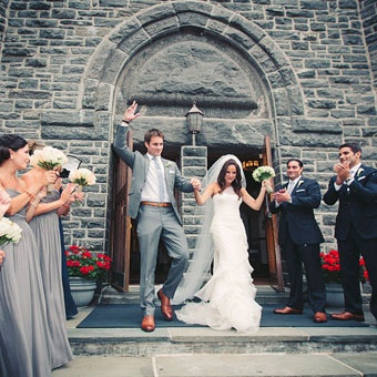 Grey suit with cognac accessories and navy groomsmen.    Brides: A Romantic Yacht Club Wedding