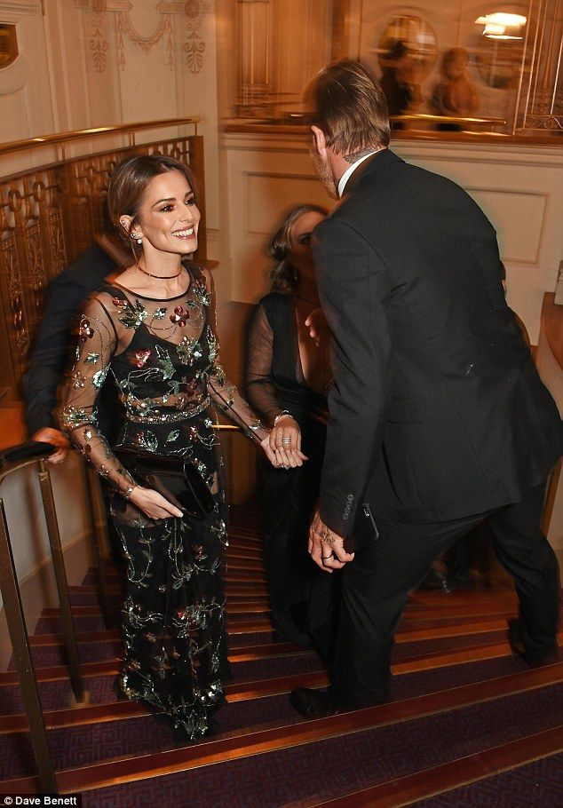 Mwah! Cheryl bumps into a sharp-suited David Beckham on the stairs - and they share a kiss