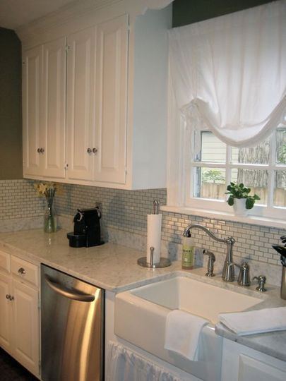 Cape Cod--kitchen redo. Love the tile back splash and all white!