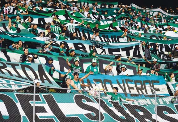 Fans of Colombia's Atletico Nacional at a Sudamericana Cup game away to Cesar Vallejo of Peru