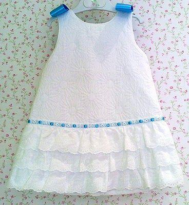 white pique dress with flounces