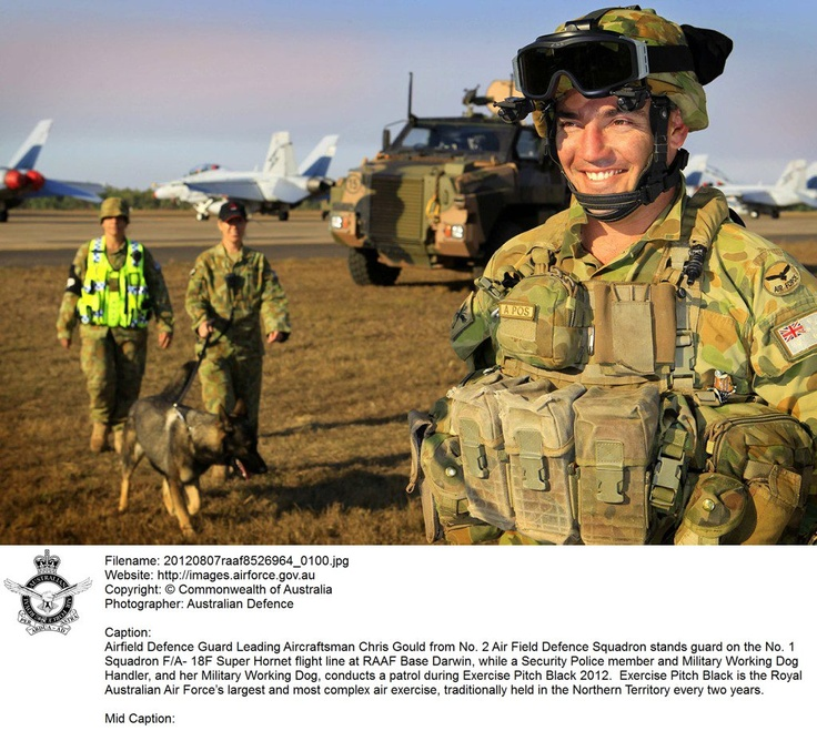 20120807raaf8526964_0100.JPG    Airfield Defence Guard Leading Aircraftsman Chris Gould from No. 2 Air Field Defence Squadron stands guard on the No. 1 Squadron F/A- 18F Super Hornet flight line at RAAF Base Darwin, while a Security Police member and Military Working Dog Handler, and her Military Working Dog, conducts a patrol during Exercise Pitch Black 2012. Exercise Pitch Black is the Royal Australian Air Force's largest and most complex air exercise.  © Commonwealth of Australia
