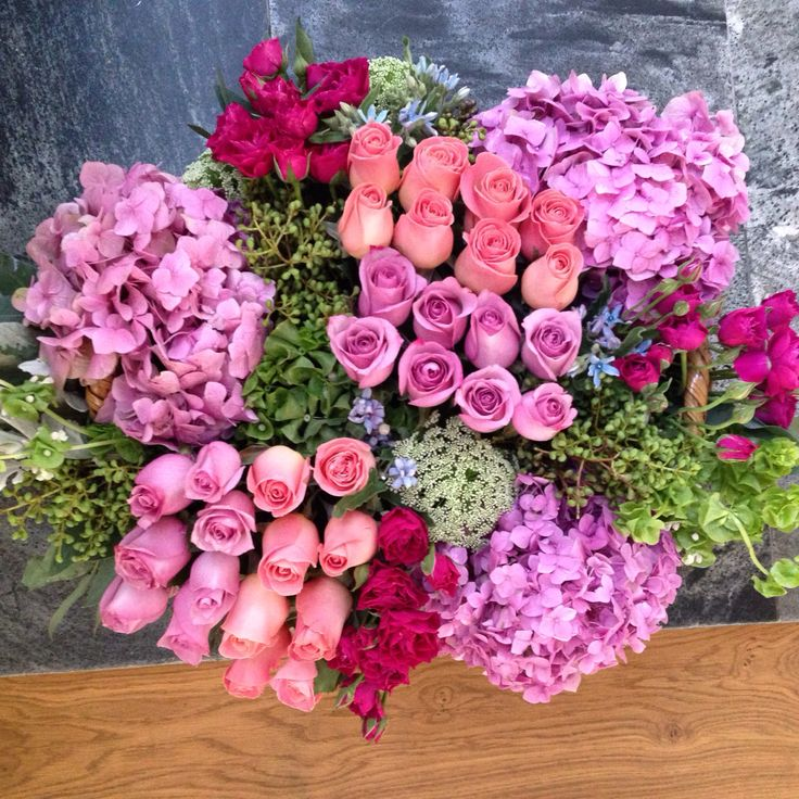 Pink  roses and baby roses flower arrangement