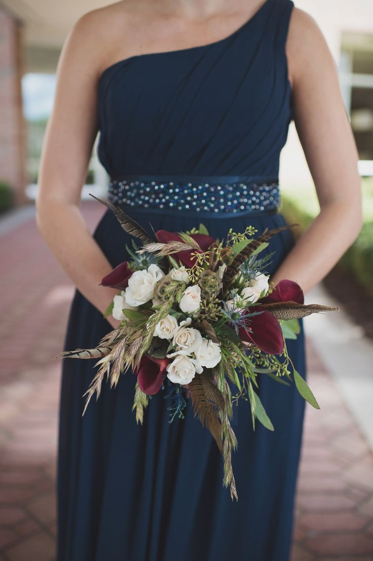 Bridesmaid bouquets and all centerpieces contained pheasants feathers // Jordanne + Ryan Photography